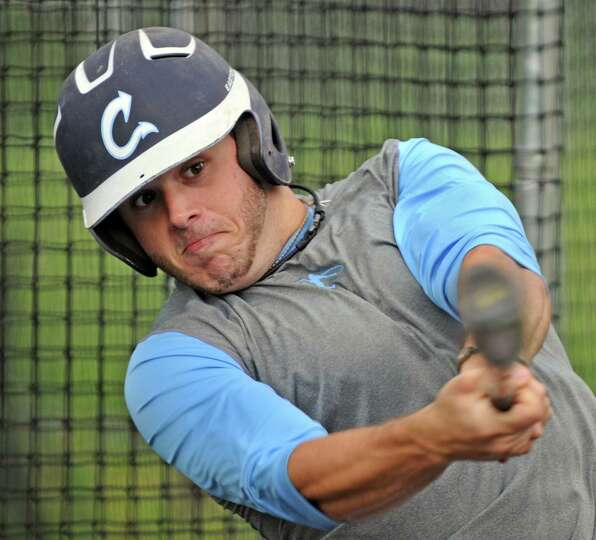 Columbia High School baseball player Jonas Godell takes swings in the batting cage as he and his tea