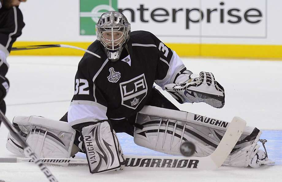 Los Angeles Kings goalie Jonathan Quick (32) deflects a shot in the first period against the New Jersey Devils during Game 3 of the Stanley Cup Finals, Monday, June 4, 2012, in Los Angeles.  The Kings won 4-0. (AP Photo/Mark J. Terrill) Photo: Mark J. Terrill, Associated Press