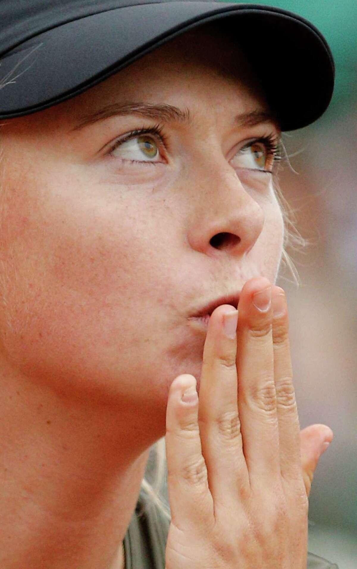 Russia's Maria Sharapova blows a kiss tothe public after defeating Czech Republic's Klara Zakopalova during their fourth round match in the French Open tennis tournament at the Roland Garros stadium in Paris, Monday, June 4, 2012. Sharapova won 6-4, 6-7, 6-2. (AP Photo/Christophe Ena)