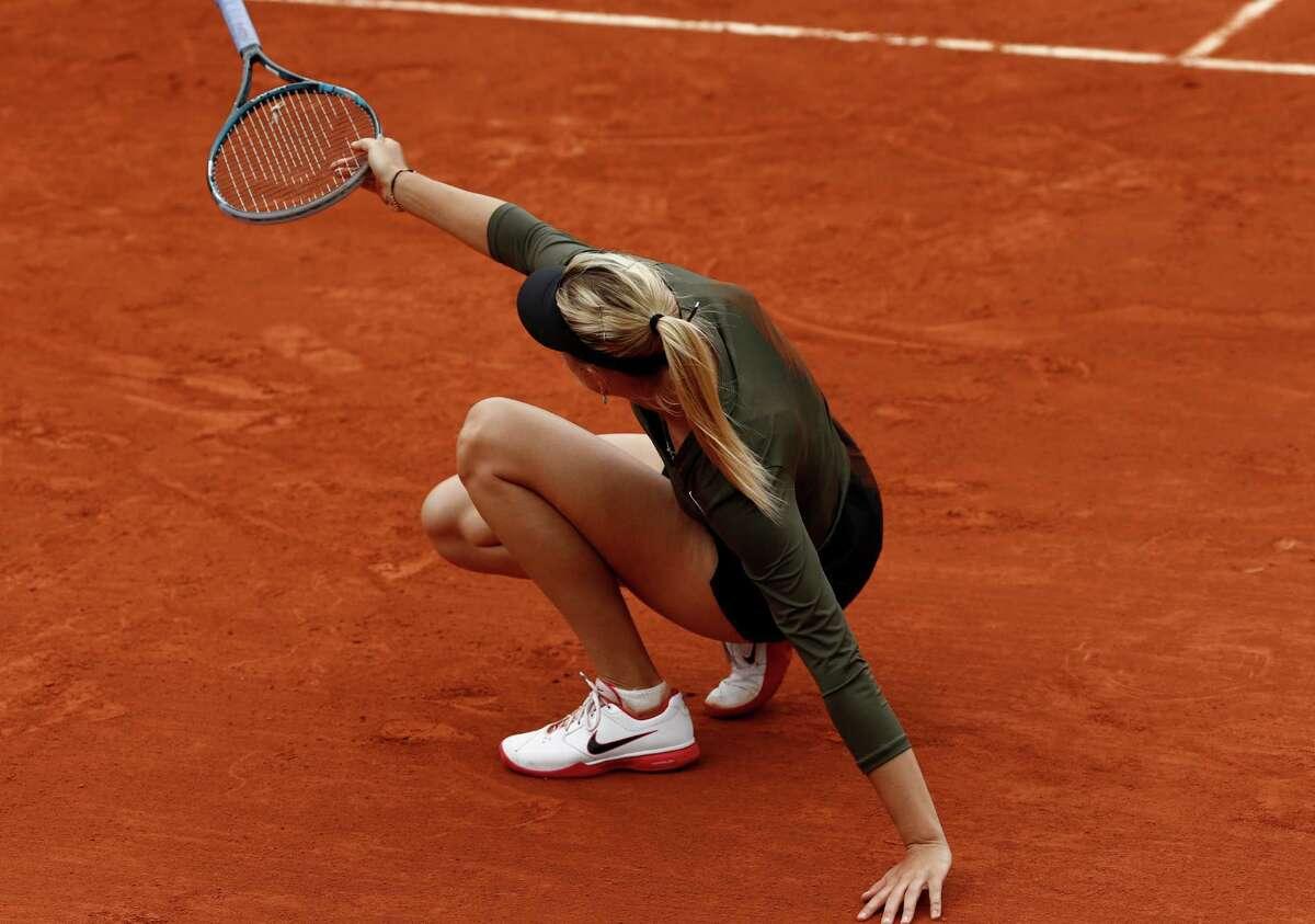 Russia's Maria Sharapova slips on the clay as she plays Czech Republic's Klara Zakopalova during their fourth round match in the French Open tennis tournament at the Roland Garros stadium in Paris, Monday, June 4, 2012. (AP Photo/Bernat Armangue)