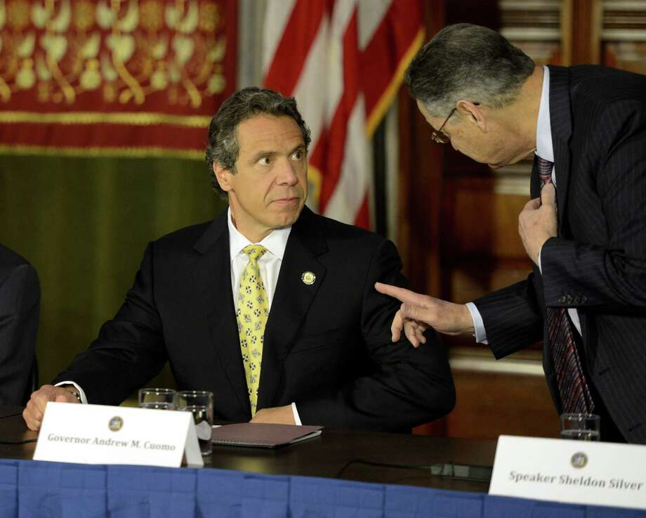 Gov. Andrew Cuomo speaks with Assembly Speaker Shelly Silver before he discussed lowering the penalty for public possession of a small amount of marijuana, reducing it from a misdemeanor to a violation during a press conference in the Red Room of the State Capitol in Albany, N.Y. June 4, 2012.   (Skip Dickstein / Times Union) Photo: Skip Dickstein