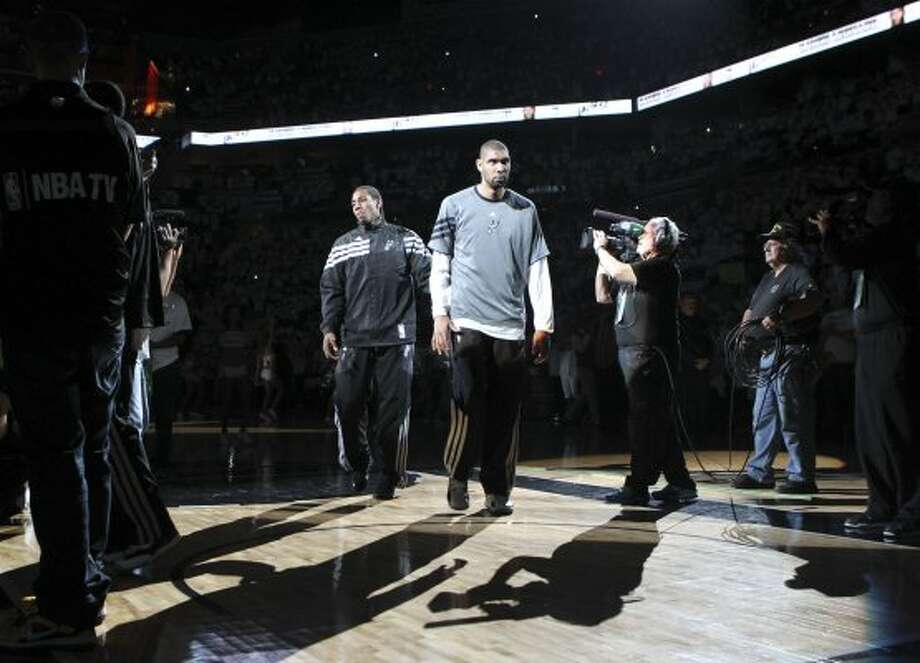 San Antonio Spurs' Tim Duncan (21) walks on the court during team introductions before the first half of game five of the NBA Western Conference Finals in San Antonio, Texas on Monday, June 4, 2012. (Kin Man Hui / San Antonio Express-News)