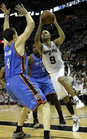 San Antonio Spurs' Tony Parker (9) drives against Oklahoma City Thunder's Nick Collison (4) during the first half of game five of the NBA Western Conference Finals in San Antonio, Texas on Monday, June 4, 2012. (Kin Man Hui / San Antonio Express-News)