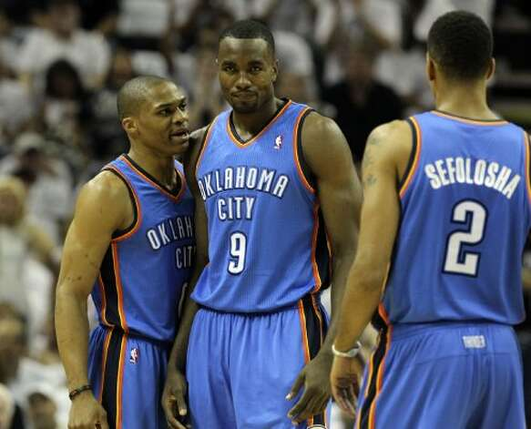 Oklahoma City Thunder's Russell Westbrook (0) talks to Oklahoma City Thunder's Serge Ibaka (9) near Oklahoma City Thunder's Thabo Sefolosha (2) during the first half of game five of the NBA Western Conference Finals in San Antonio, Texas on Monday, June 4, 2012. (Kin Man Hui / San Antonio Express-News)
