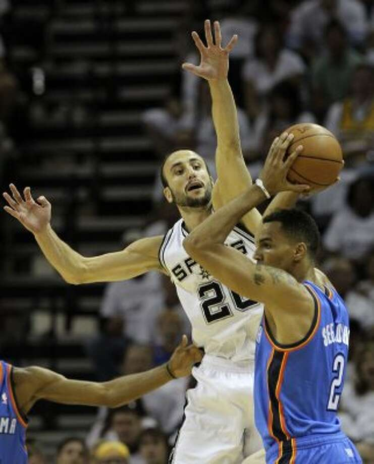 San Antonio Spurs' Manu Ginobili (20) guards Oklahoma City Thunder's Thabo Sefolosha (2) during the first half of game five of the NBA Western Conference Finals in San Antonio, Texas on Monday, June 4, 2012. (Kin Man Hui / San Antonio Express-News)
