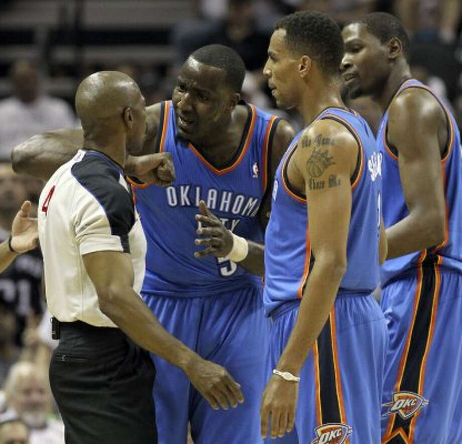 Oklahoma City Thunder's Kendrick Perkins (5) talks to official Tom Washington as Oklahoma City Thunder's Thabo Sefolosha (2) and Oklahoma City Thunder's Kevin Durant (35) listen during the first half of game five of the NBA Western Conference Finals in San Antonio, Texas on Monday, June 4, 2012. (Kin Man Hui / San Antonio Express-News)
