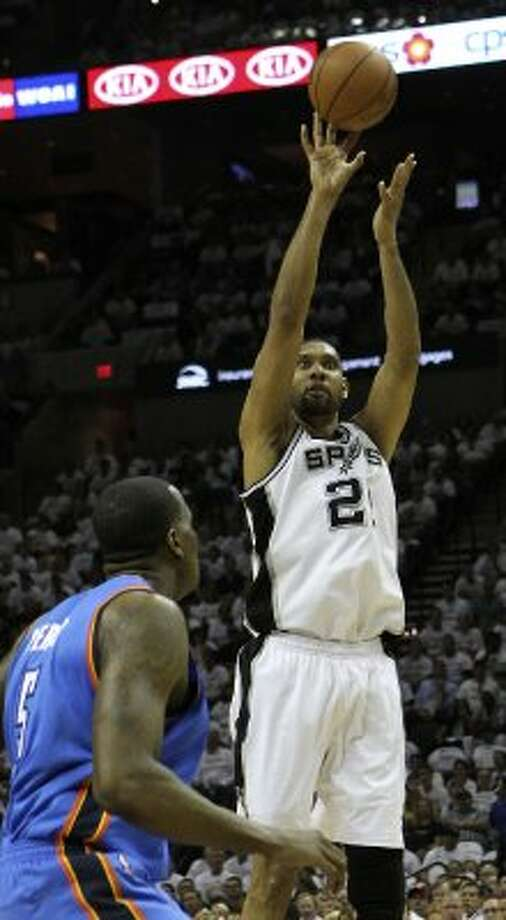 San Antonio Spurs' Tim Duncan (21) shoots over Oklahoma City Thunder's Kendrick Perkins (5) during the first half of game five of the NBA Western Conference Finals in San Antonio, Texas on Monday, June 4, 2012. (Kin Man Hui / San Antonio Express-News)