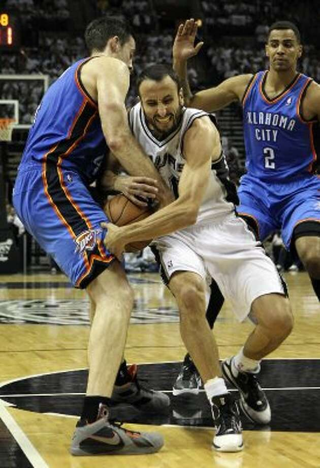 San Antonio Spurs' Manu Ginobili (20) and Oklahoma City Thunder's Nick Collison (4) fight for control of the ball during the first half of game five of the NBA Western Conference Finals in San Antonio, Texas on Monday, June 4, 2012. (Kin Man Hui / San Antonio Express-News)