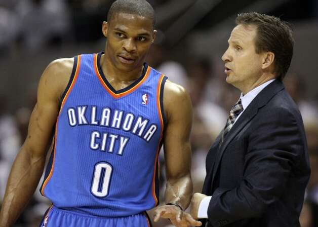 Oklahoma City Thunder head coach Scott Brooks talks to Oklahoma City Thunder's Russell Westbrook (0) during the first half of game five of the NBA Western Conference Finals in San Antonio, Texas on Monday, June 4, 2012. (Jerry Lara / San Antonio Express-News)