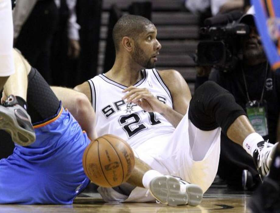 San Antonio Spurs' Tim Duncan (21) reacts after being called for a charging foul during the first half of game five of the NBA Western Conference Finals in San Antonio, Texas on Monday, June 4, 2012. (Jerry Lara / San Antonio Express-News)