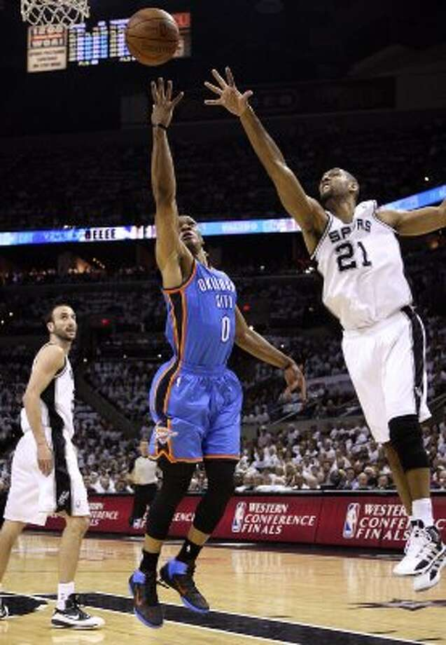 Oklahoma City Thunder's Russell Westbrook (0) shoots against San Antonio Spurs' Tim Duncan (21) during the first half of game five of the NBA Western Conference Finals in San Antonio, Texas on Monday, June 4, 2012. (Jerry Lara / San Antonio Express-News)