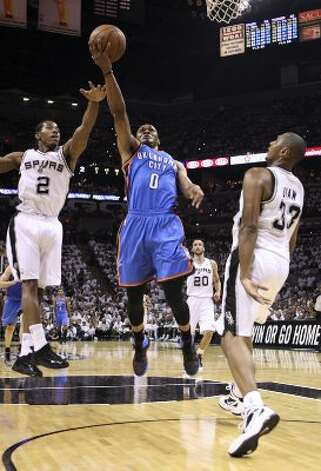 Oklahoma City Thunder's Russell Westbrook (0) shoots against San Antonio Spurs' Kawhi Leonard (2) and San Antonio Spurs' Boris Diaw (33) during the first half of game five of the NBA Western Conference Finals in San Antonio, Texas on Monday, June 4, 2012. (Jerry Lara / San Antonio Express-News)