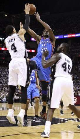 Oklahoma City Thunder's Kevin Durant (35) shoots against San Antonio Spurs' Danny Green (4) and San Antonio Spurs' DeJuan Blair (45) during the first half of game five of the NBA Western Conference Finals in San Antonio, Texas on Monday, June 4, 2012. (Jerry Lara / San Antonio Express-News)