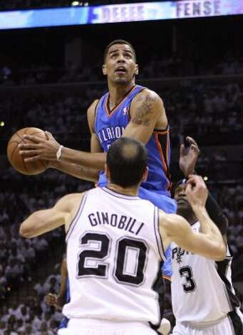 Oklahoma City Thunder's Thabo Sefolosha (2) is guarded by San Antonio Spurs' Manu Ginobili (20) and San Antonio Spurs' Stephen Jackson (3) during the first half of game five of the NBA Western Conference Finals in San Antonio, Texas on Monday, June 4, 2012. (Jerry Lara / San Antonio Express-News)
