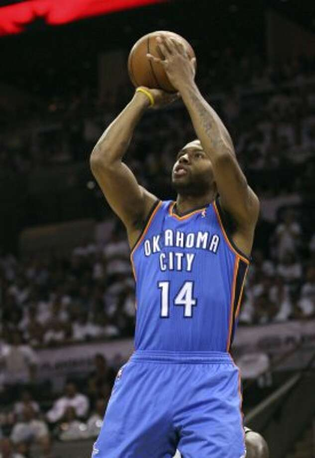 Oklahoma City Thunder's Daequan Cook (14) shoots the ball during the first half of game five of the NBA Western Conference Finals in San Antonio, Texas on Monday, June 4, 2012. (Jerry Lara / San Antonio Express-News)