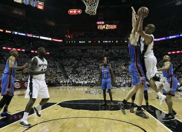 San Antonio Spurs' Tony Parker (9) shoots against Oklahoma City Thunder's Nick Collison (4) during the first half of game five of the NBA Western Conference Finals in San Antonio, Texas on Monday, June 4, 2012. (Jerry Lara / San Antonio Express-News)