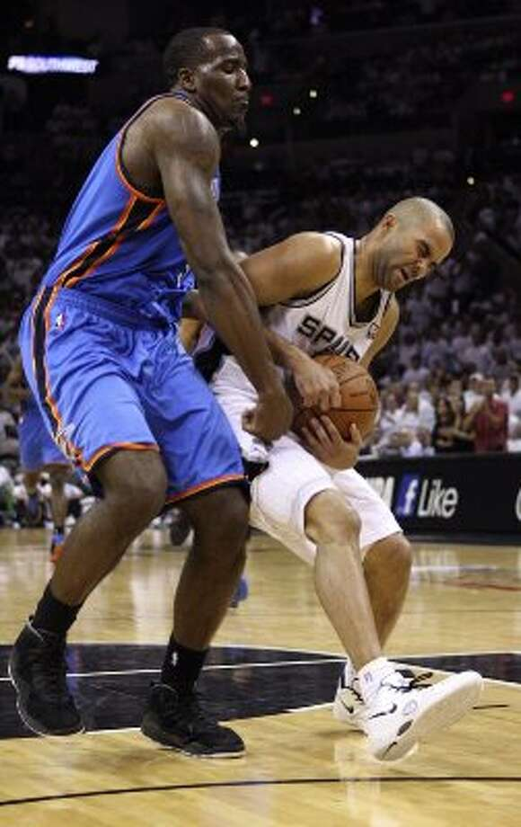 Oklahoma City Thunder's Kendrick Perkins (5) fouls San Antonio Spurs' Tony Parker (9) during the second half of game five of the NBA Western Conference Finals in San Antonio, Texas on Monday, June 4, 2012. (San Antonio Express-News)