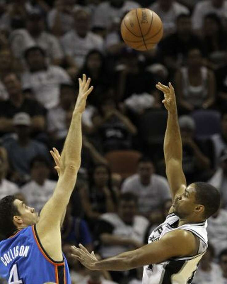 San Antonio Spurs' Gary Neal (14) shoots against Oklahoma City Thunder's Nick Collison (4) during the second half of game five of the NBA Western Conference Finals in San Antonio, Texas on Monday, June 4, 2012. (San Antonio Express-News)