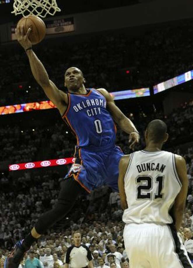 Oklahoma City Thunder's Russell Westbrook (0) drives against San Antonio Spurs' Tim Duncan (21) during the second half of game five of the NBA Western Conference Finals in San Antonio, Texas on Monday, June 4, 2012. (San Antonio Express-News)