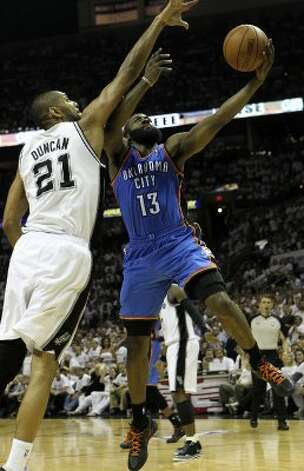 Oklahoma City Thunder's James Harden (13) drives against San Antonio Spurs' Tim Duncan (21) during the second half of game five of the NBA Western Conference Finals in San Antonio, Texas on Monday, June 4, 2012. (San Antonio Express-News)