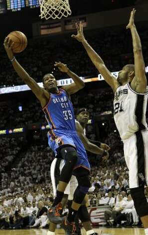 Oklahoma City Thunder's Kevin Durant (35) drives against San Antonio Spurs' Tim Duncan (21) during the second half of game five of the NBA Western Conference Finals in San Antonio, Texas on Monday, June 4, 2012. (San Antonio Express-News)