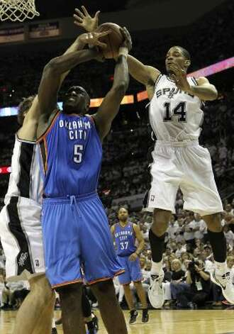 Oklahoma City Thunder's Kendrick Perkins (5) is pressured by San Antonio Spurs' Tiago Splitter (22) and San Antonio Spurs' Gary Neal (14) during the second half of game five of the NBA Western Conference Finals in San Antonio, Texas on Monday, June 4, 2012. (San Antonio Express-News)