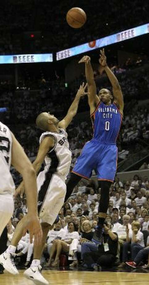 Oklahoma City Thunder's Russell Westbrook (0) shoots over San Antonio Spurs' Tony Parker (9) during the second half of game five of the NBA Western Conference Finals in San Antonio, Texas on Monday, June 4, 2012. (San Antonio Express-News)
