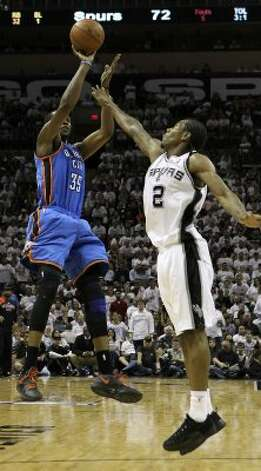 Oklahoma City Thunder's Kevin Durant (35) shoots over San Antonio Spurs' Kawhi Leonard (2) during the second half of game five of the NBA Western Conference Finals in San Antonio, Texas on Monday, June 4, 2012. (San Antonio Express-News)