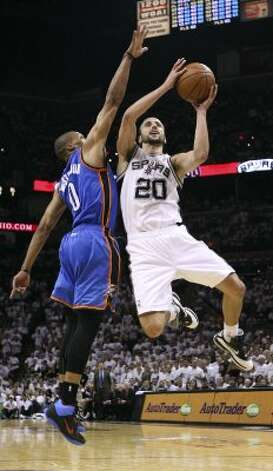 San Antonio Spurs' Manu Ginobili (20) drives against Oklahoma City Thunder's Russell Westbrook (0) during the first half of game five of the NBA Western Conference Finals in San Antonio, Texas on Monday, June 4, 2012. (San Antonio Express-News)