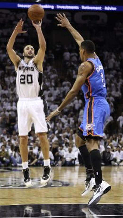 San Antonio Spurs' Manu Ginobili (20) shoots over Oklahoma City Thunder's Thabo Sefolosha (2) during the first half of game five of the NBA Western Conference Finals in San Antonio, Texas on Monday, June 4, 2012. (San Antonio Express-News)