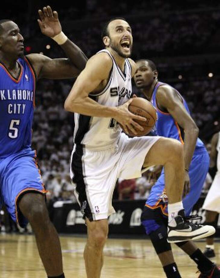 San Antonio Spurs' Manu Ginobili (20) drives against Oklahoma City Thunder's Kendrick Perkins (5) during the first half of game five of the NBA Western Conference Finals in San Antonio, Texas on Monday, June 4, 2012. (San Antonio Express-News)