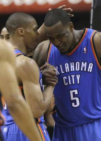 Oklahoma City Thunder's Russell Westbrook (0) greets Oklahoma City Thunder's Kendrick Perkins (5) during the first half of game five of the NBA Western Conference Finals in San Antonio, Texas on Monday, June 4, 2012. (San Antonio Express-News)