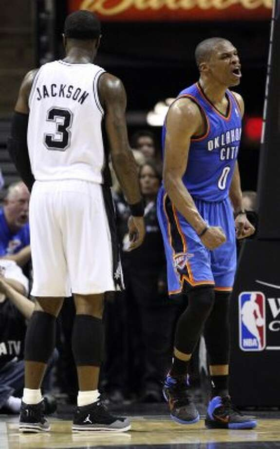 Oklahoma City Thunder's Russell Westbrook (0) reacts near San Antonio Spurs' Stephen Jackson (3) during the first half of game five of the NBA Western Conference Finals in San Antonio, Texas on Monday, June 4, 2012. (San Antonio Express-News)