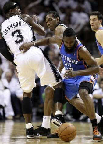 Oklahoma City Thunder's James Harden (13) dribbles near San Antonio Spurs' Stephen Jackson (3) during the first half of game five of the NBA Western Conference Finals in San Antonio, Texas on Monday, June 4, 2012. (San Antonio Express-News)