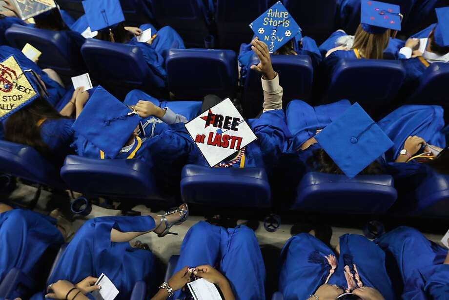 MIAMI, FL - JUNE 04:  A graduate wears his mortarboard with Free at Last written on it as Vice President Joe Biden speaks during the commencement ceremony for Cypress Bay High School graduates at Marlins Park on June 4, 2012 in Miami, Florida. With Florida being an important swing state in the national election both Biden and President Barack Obama along with the Republican challengers are expected to make more campaign appearances before voters head to the polls in November.  (Photo by Joe Raedle/Getty Images) Photo: Joe Raedle, Getty Images