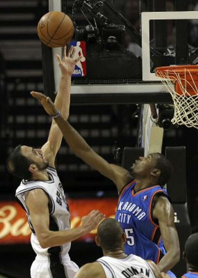 San Antonio Spurs' Manu Ginobili (20) shoots over Oklahoma City Thunder's Kevin Durant (35) during the second half of game five of the NBA Western Conference Finals in San Antonio, Texas on Monday, June 4, 2012.  The Thunder won 108-103. (Kin Man Hui  / San Antonio Express-News)