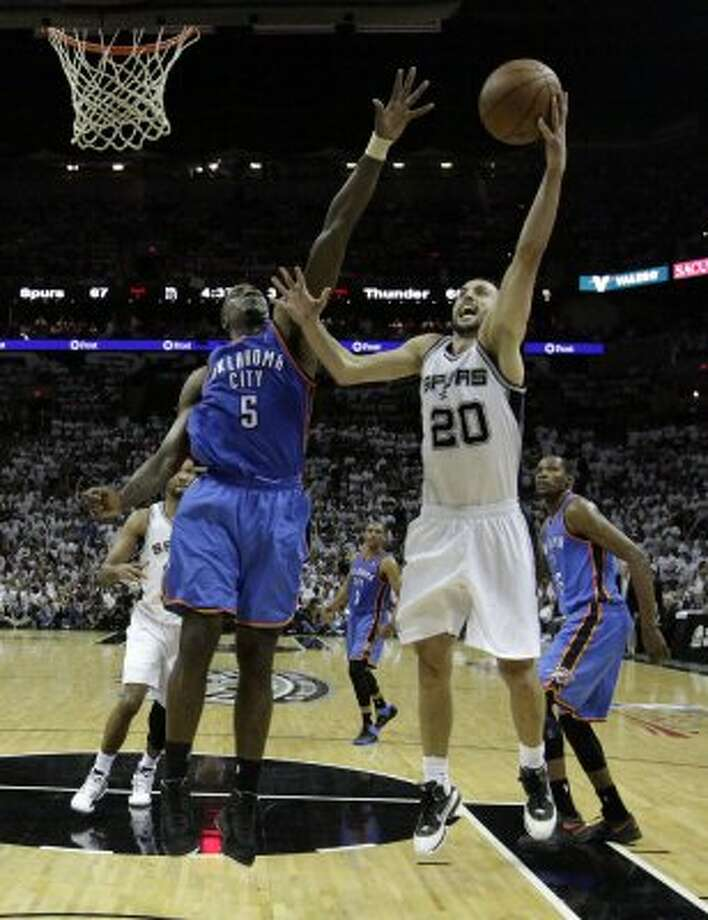 San Antonio Spurs' Manu Ginobili (20) shoots over Oklahoma City Thunder's Kendrick Perkins (5) during the second half of game five of the NBA Western Conference Finals in San Antonio, Texas on Monday, June 4, 2012.  The Thunder won 108-103. (Kin Man Hui / San Antonio Express-News)