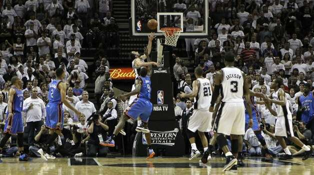 San Antonio Spurs' Manu Ginobili (20) shoots over Oklahoma City Thunder's Serge Ibaka (9) during the second half of game five of the NBA Western Conference Finals in San Antonio, Texas on Monday, June 4, 2012.  The Thunder won 108-103. (Kin Man Hui / San Antonio Express-News)