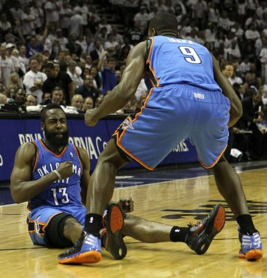 Oklahoma City Thunder's James Harden (13) reacts after being fouled and hitting a three point basket near Oklahoma City Thunder's Serge Ibaka (9) during the second half of game five of the NBA Western Conference Finals in San Antonio, Texas on Monday, June 4, 2012.  The Thunder won 108-103. (Kin Man Hui / San Antonio Express-News)