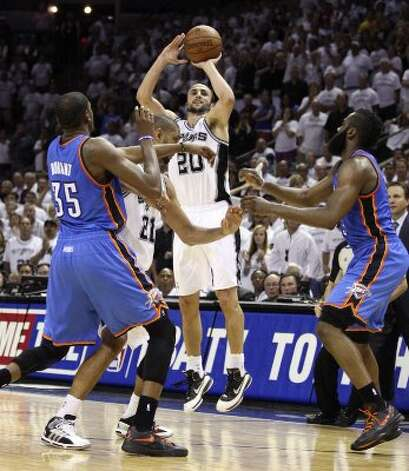 San Antonio Spurs' Manu Ginobili (20) shoots a three point basket during the second half of game five of the NBA Western Conference Finals in San Antonio, Texas on Monday, June 4, 2012.  The Thunder won 108-103.  Ginobili missed the shot to tie the game. (Jerry Lara / San Antonio Express-News)