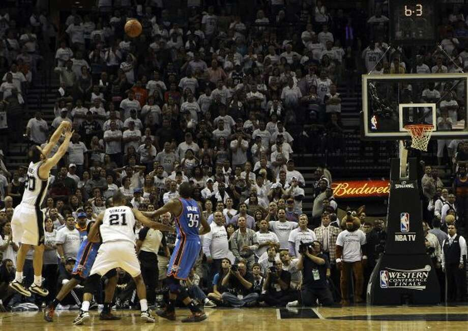 San Antonio Spurs' Manu Ginobili (20) shoots a three point basket during the second half of game five of the NBA Western Conference Finals in San Antonio, Texas on Monday, June 4, 2012.  The Thunder won 108-103. (Kin Man Hui / San Antonio Express-News)