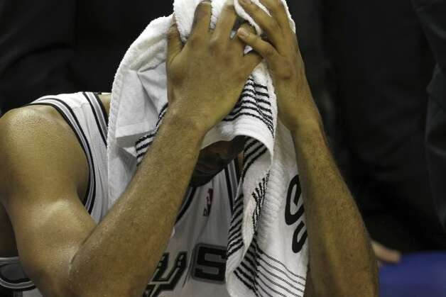 San Antonio Spurs' Tim Duncan (21) holds a towel over his head near the end of game five of the NBA Western Conference Finals in San Antonio, Texas on Monday, June 4, 2012.  The Thunder won 108-103. (Kin Man Hui / San Antonio Express-News)