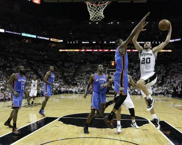 San Antonio Spurs' Manu Ginobili (20) shoots over Oklahoma City Thunder's Kevin Durant (35) during the second half of game five of the NBA Western Conference Finals in San Antonio, Texas on Monday, June 4, 2012.  The Thunder won 108-103. (San Antonio Express-News)