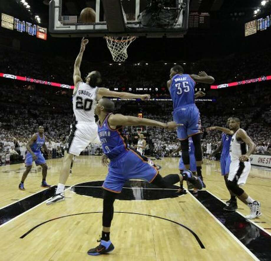 San Antonio Spurs' Manu Ginobili (20) lays in the ball during the second half of game five of the NBA Western Conference Finals in San Antonio, Texas on Monday, June 4, 2012.  The Thunder won 108-103. (San Antonio Express-News)