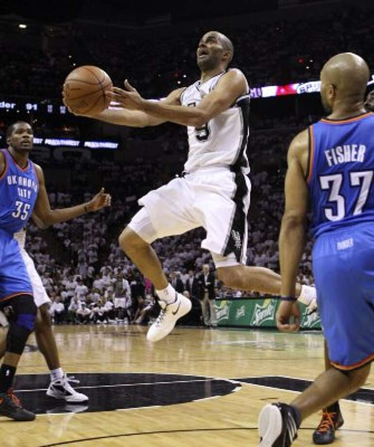 San Antonio Spurs' Tony Parker (9) goes to the basket during the second half of game five of the NBA Western Conference Finals in San Antonio, Texas on Monday, June 4, 2012.  The Thunder won 108-103. (San Antonio Express-News)