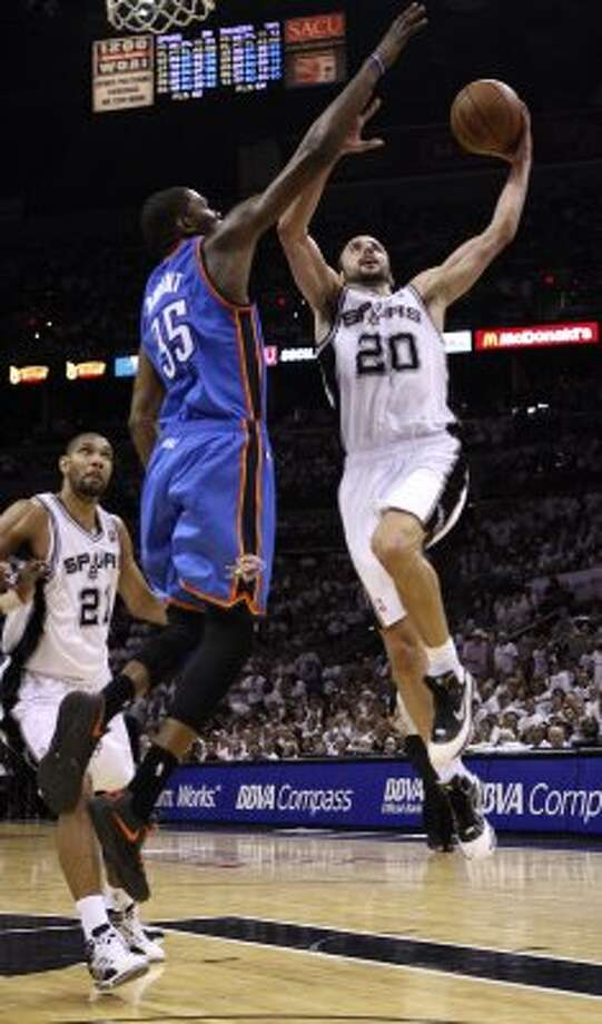 San Antonio Spurs' Manu Ginobili (20) goes to the basket against Oklahoma City Thunder's Kevin Durant (35) during the second half of game five of the NBA Western Conference Finals in San Antonio, Texas on Monday, June 4, 2012.  The Thunder won 108-103. (San Antonio Express-News)