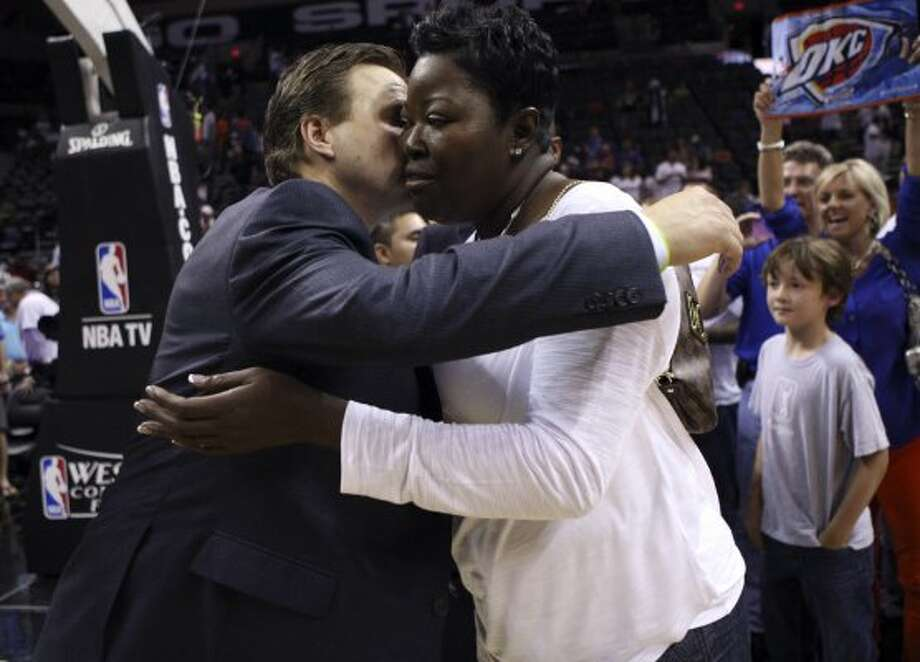 Oklahoma City Thunder head coach Scott Brooks hugs Wanda Pratt, Kevin Durant's mother, after game five of the NBA Western Conference Finals in San Antonio, Texas on Monday, June 4, 2012.  The Thunder won 108-103. (San Antonio Express-News)
