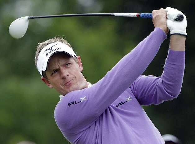 Luke Donald, of England, hits his tee shot on the first hole during the second round of the Memorial golf tournament Friday, June 1, 2012, in Dublin, Ohio. Donald parred the hole. (AP Photo/Jay LaPrete) Photo: Jay LaPrete, Associated Press