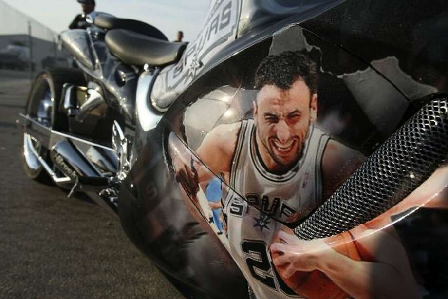 San Antonio Spurs' Manu Ginobili (20) is featured on the 2009 Suzuki Hayabusa before game five of the NBA Western Conference Finals in San Antonio, Texas on Monday, June 4, 2012.  Bike owner Philip Lozano said he started applying Spurs details to the bike last week. (San Antonio Express-News)