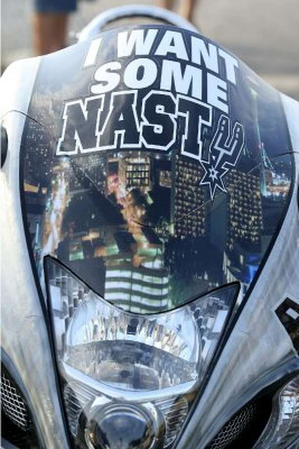 A custom Spurs 2009 Suzuki Hayabusa motorcycle in the AT&T Center parking lot before game five of the NBA Western Conference Finals in San Antonio, Texas on Monday, June 4, 2012.  Bike owner Philip Lozano said he started applying Spurs details to the bike last week. (San Antonio Express-News)